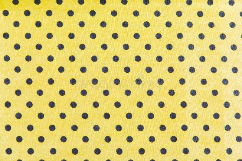 Points noirs sur le fond jaune photo stock