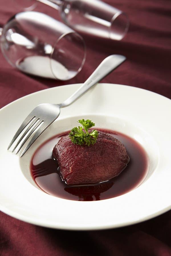 Poire en dessert de vin photos libres de droits