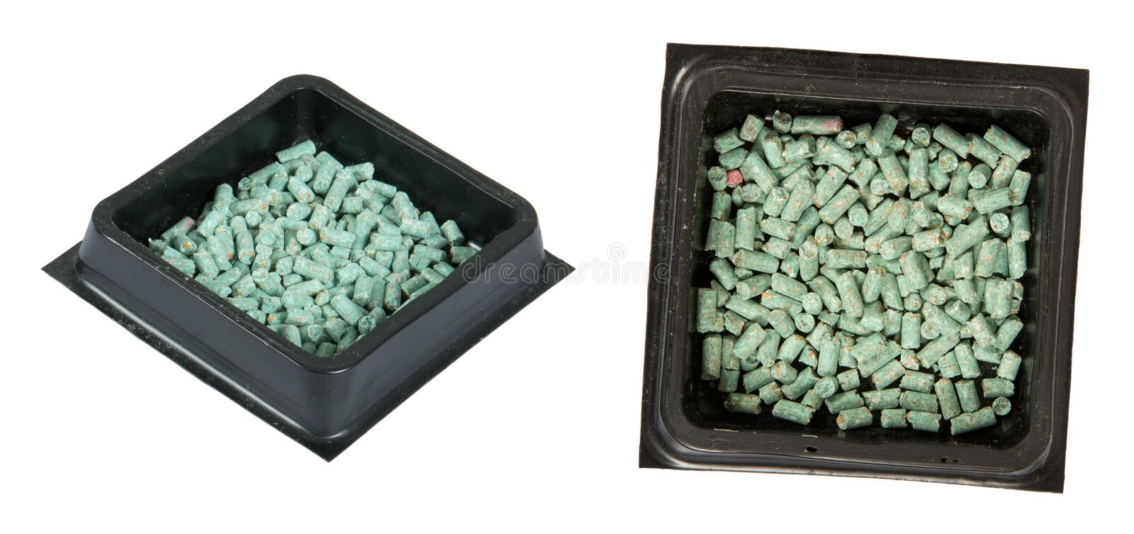 Poison Bait for a Mouse, Rat, or Rodent, Isolated. Poison bait pellets for a rat, mouse, or similar rodent and other pests. Isolated on white royalty free stock photo