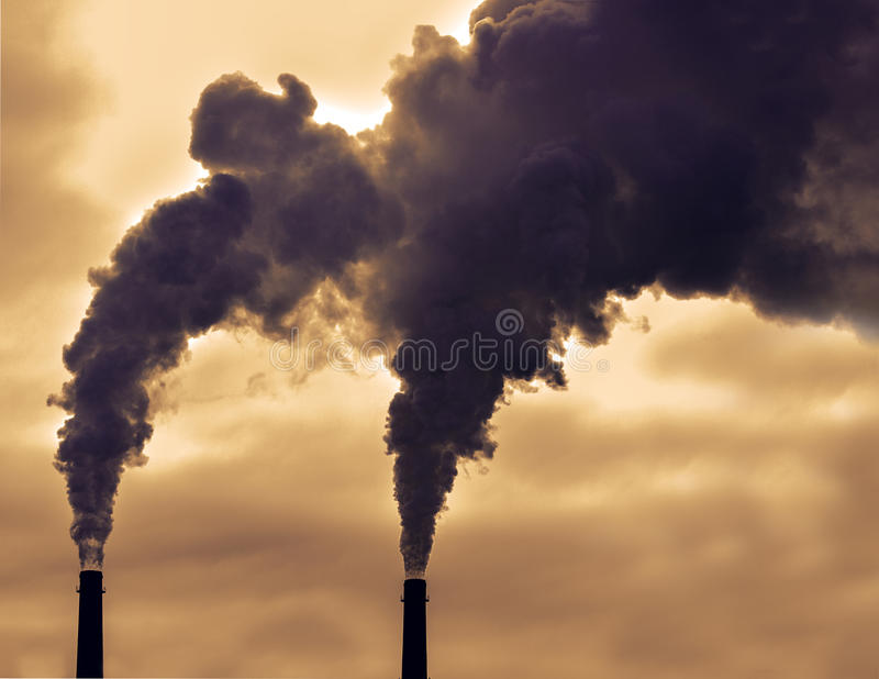 Poisoned emissions from plant stock photo