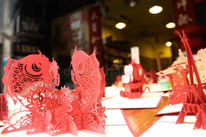 Poissons rouges - coupe de papier de chinois traditionnel photographie stock