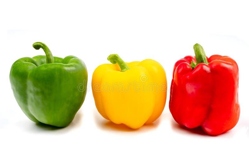 Poivre coloré de paprika sur un fond blanc photographie stock