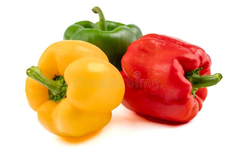 Poivre coloré de paprika sur un fond blanc photographie stock libre de droits