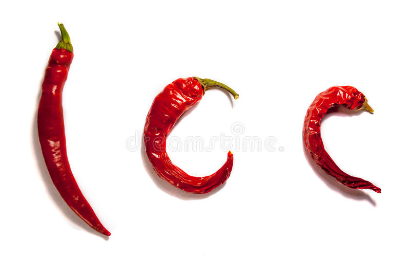 Poivre de piment d'un rouge ardent d'isolement sur le fond blanc photographie stock libre de droits