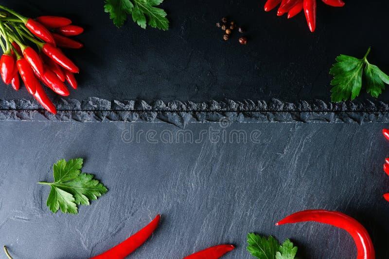 Poivre et persil de piment d'un rouge ardent image stock