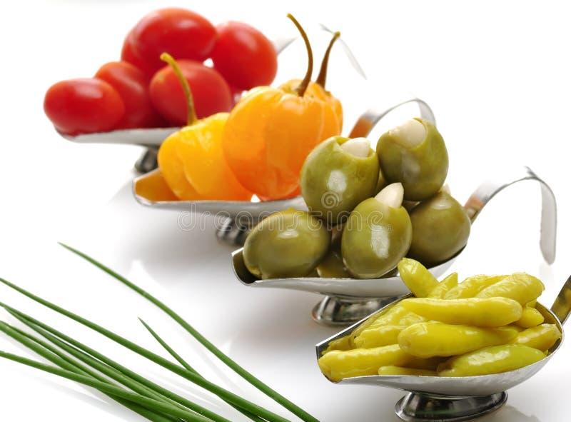 Poivre, olives et tomates photographie stock