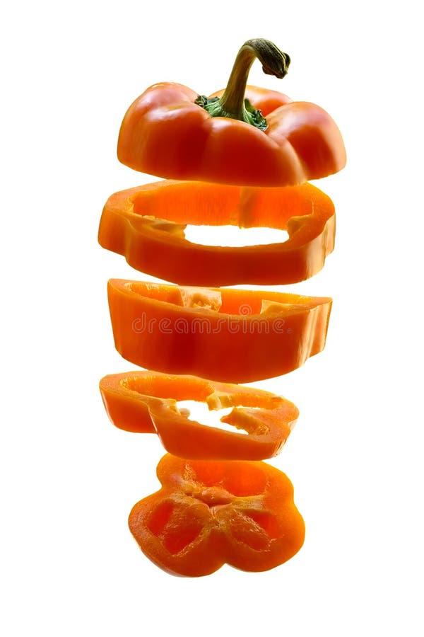 Poivre orange coupé en tranches image stock