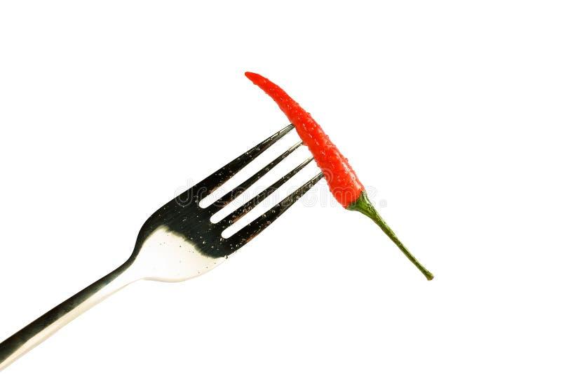 poivron rouge avec des baisses sur une fourchette d'isolement sur un fond blanc photo stock