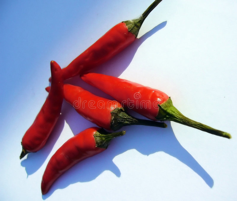 Poivrons frais d'un rouge ardent image stock