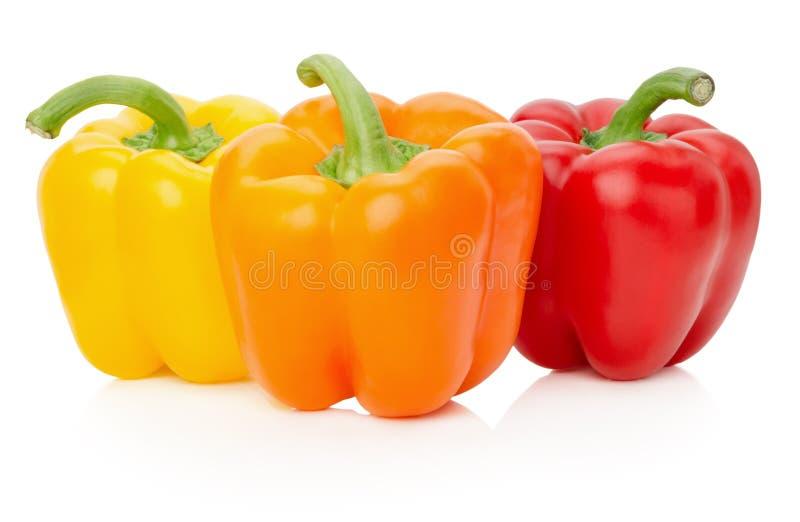 Poivrons jaunes, oranges et rouges sur le fond blanc photos stock