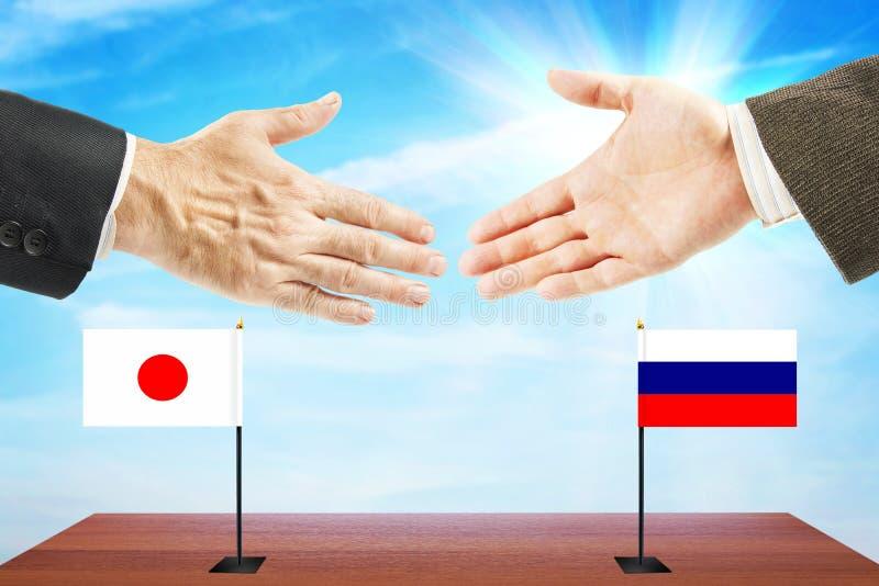 Pojęcie życzliwe rozmowy między Rosja i Japonia zdjęcia royalty free