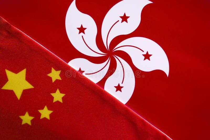 Pojęcie bilateralny związek między Chiny i Hong Kong pokazuje z dwa flagami zdjęcia stock