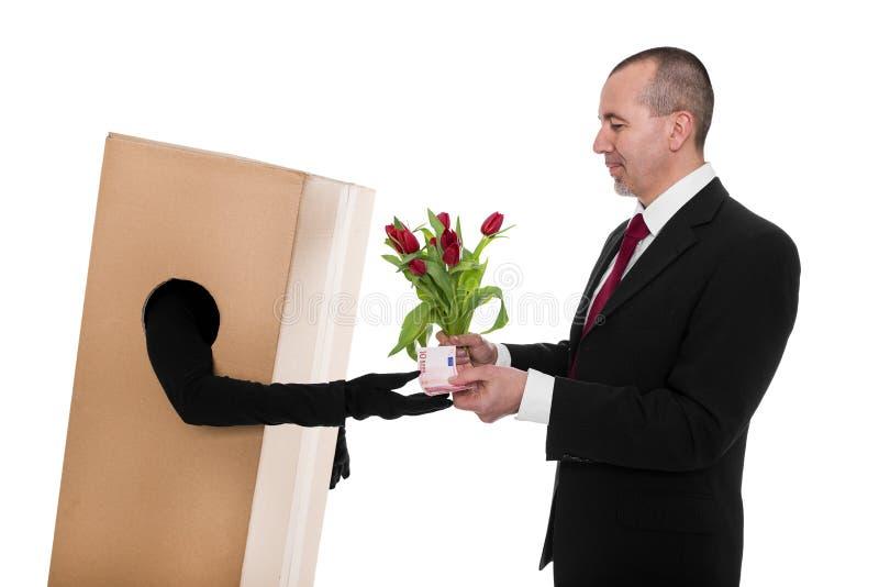 Pojęcie: Biznesmen rozkazywał kwiatu doręczyciela obraz stock