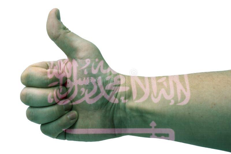 Pojęcie saudyjczyka Arabia ręka daje aprobatom z flagą Arabia Saudyjska fotografia stock