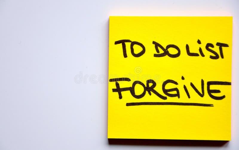 pojęcie wybacza listę zdjęcia stock