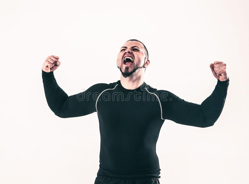 Poj?cie zwyci?stwo w szcz??liwym bodybuilder raduje si? ich Vic zdjęcie royalty free