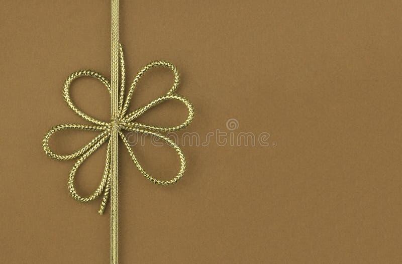 pojedynczy łęku faborek świąteczny złocisty zdjęcia royalty free
