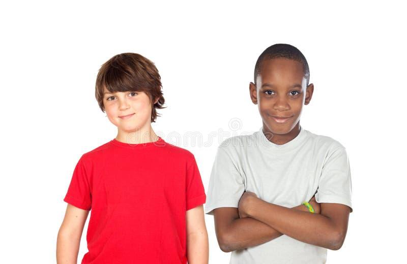pojkar två arkivfoto