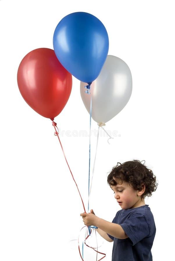 pojke för 3 ballonger little arkivfoto