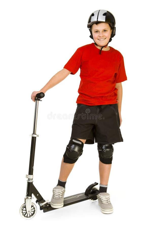 pojke hans sparkcykel royaltyfria bilder