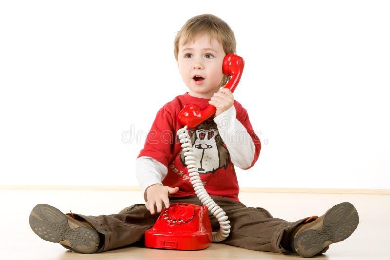 pojke little telefon royaltyfri bild