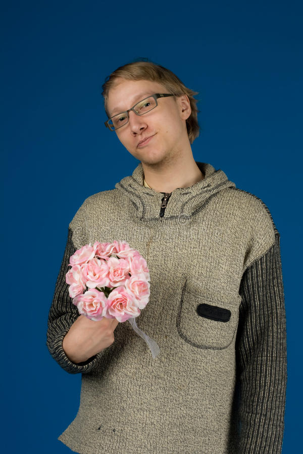 Pojke med blommor royaltyfria foton