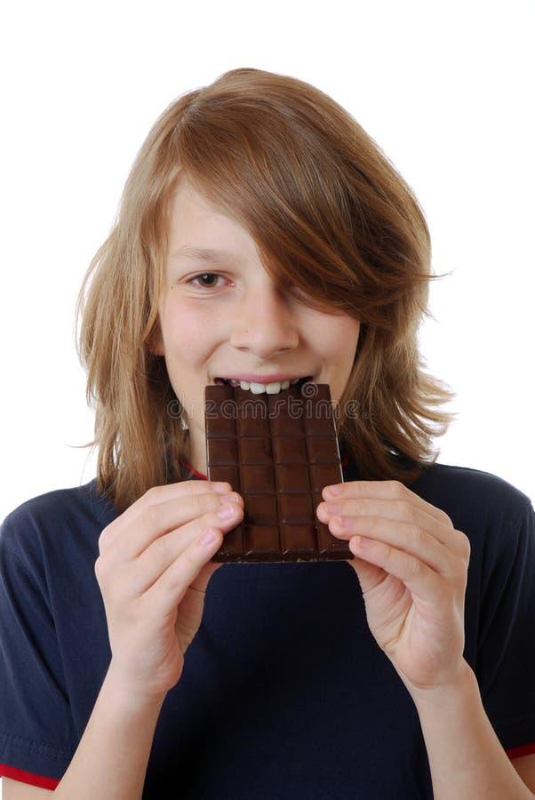 Pojke med choklad royaltyfri fotografi
