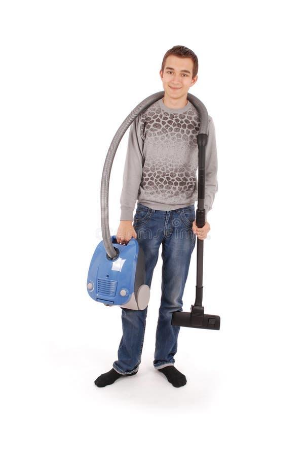 Pojke med dammsugare arkivbild