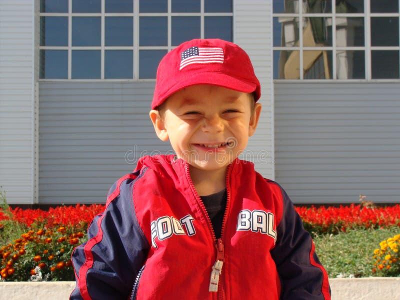 Pojke med ett stort leende arkivfoton