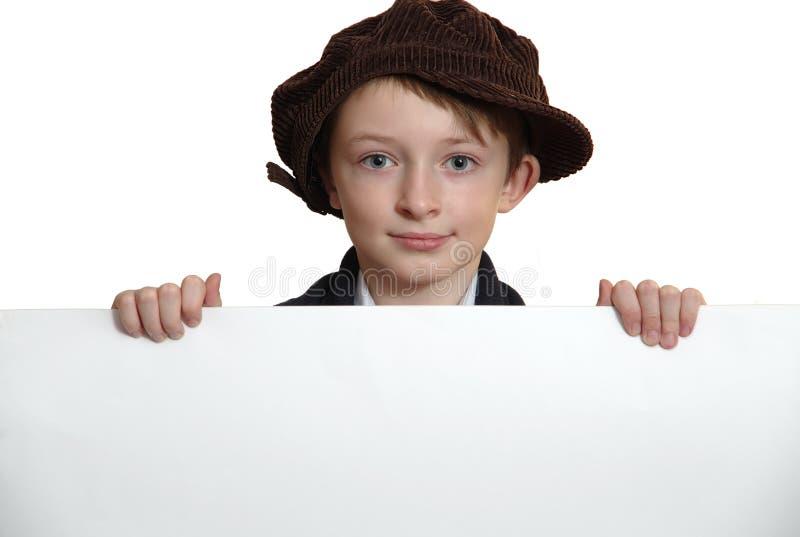 Pojke med ett vitt ark arkivfoton