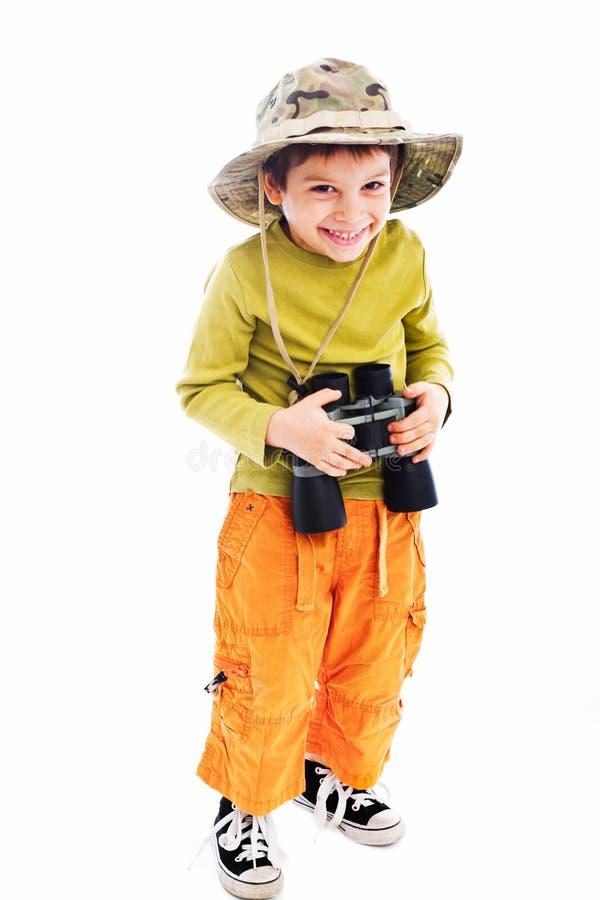 Pojke med kikare fotografering för bildbyråer