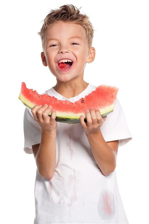 Download Pojke med vattenmelonen fotografering för bildbyråer. Bild av naturligt - 27284013