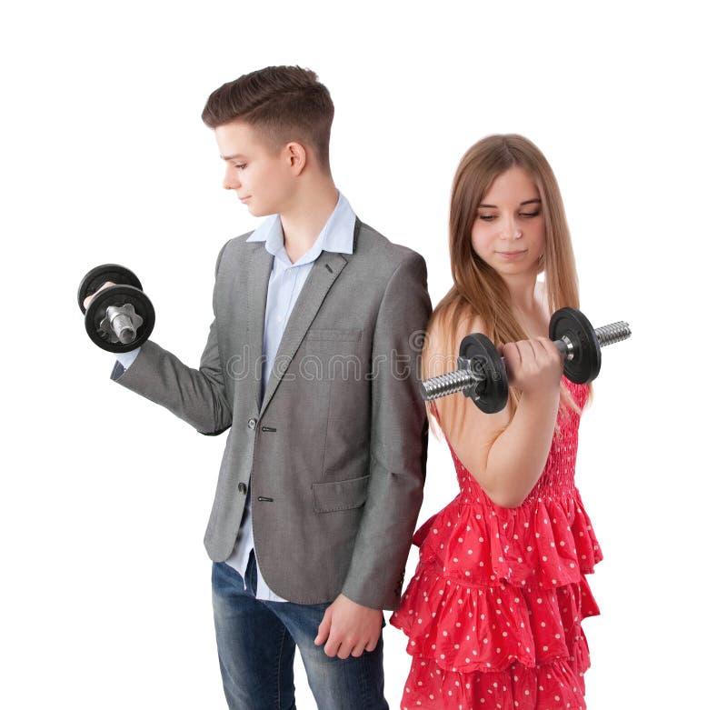 Pojke och flicka med hanteln arkivfoto