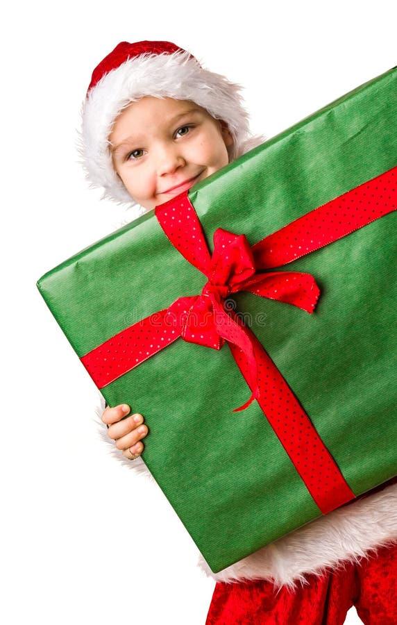Pojke- och julgåva royaltyfri bild