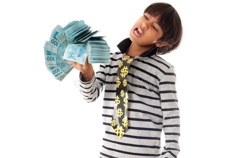 Pojke och pengar royaltyfria foton