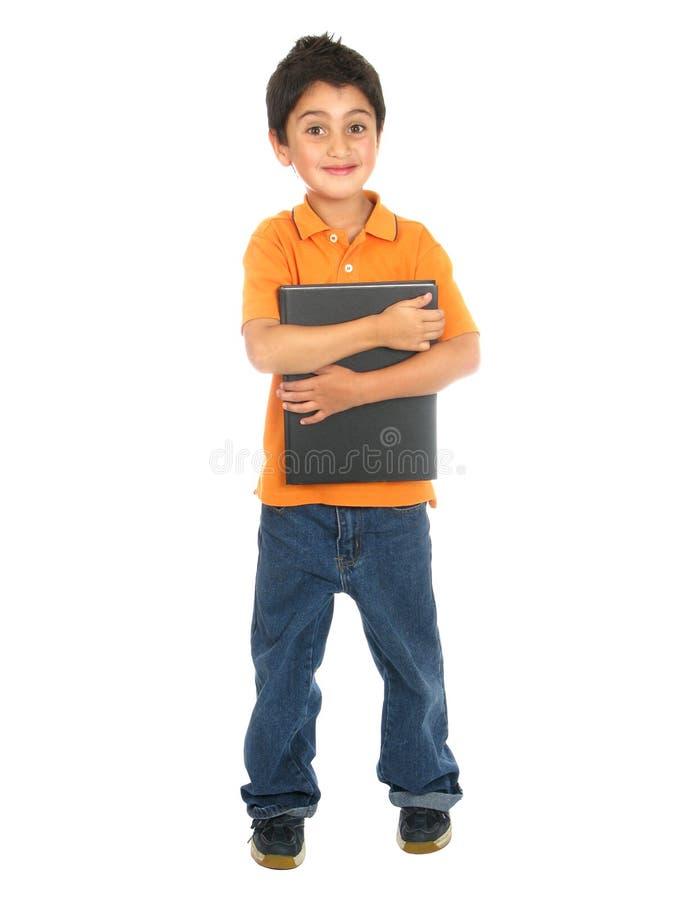 pojke som rymmer little anteckningsbokskola royaltyfria foton