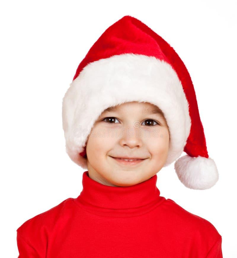pojkeclaus hatt santa royaltyfri bild
