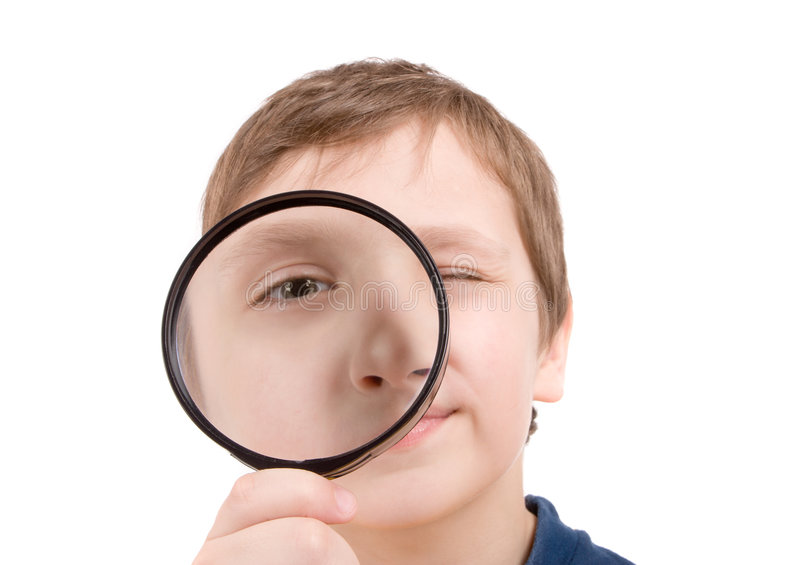 pojkeexponeringsglasförstoring royaltyfri fotografi