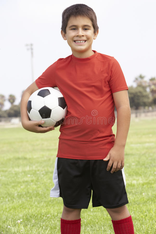 pojkefotbollslagbarn arkivfoton