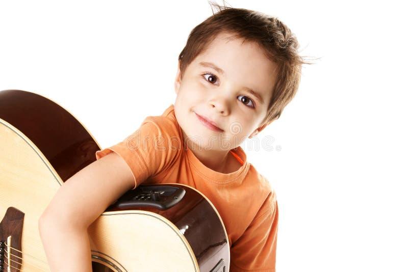 pojkegitarr arkivbild