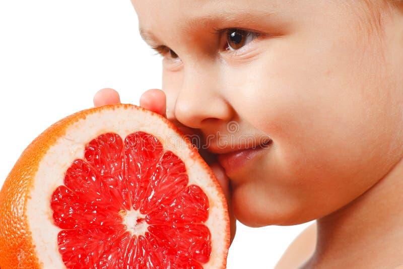 pojkegrapefrukt little pink arkivbild