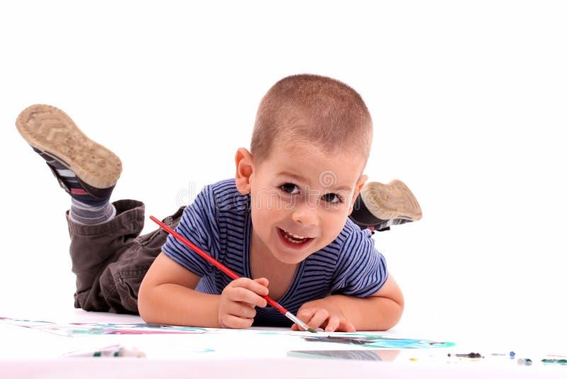 pojkemålning royaltyfri foto