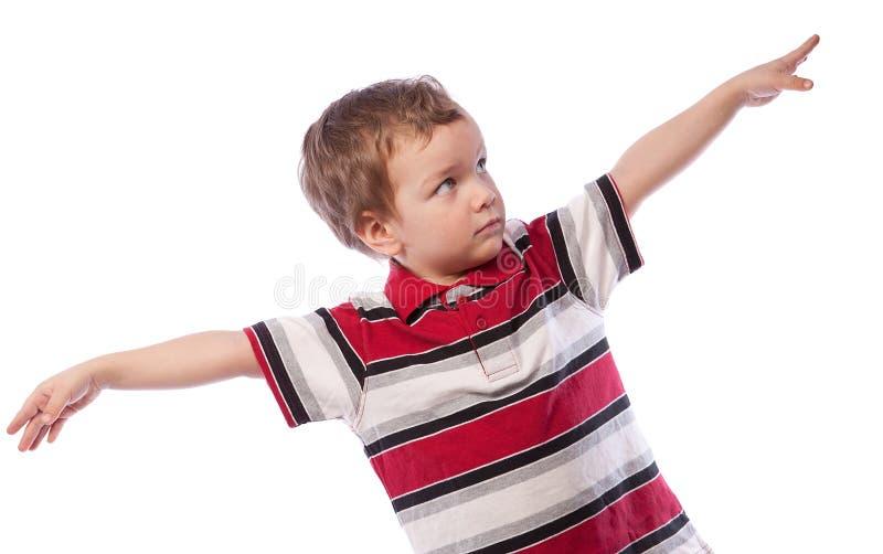 pojken hands hans små elasticiteter arkivbild
