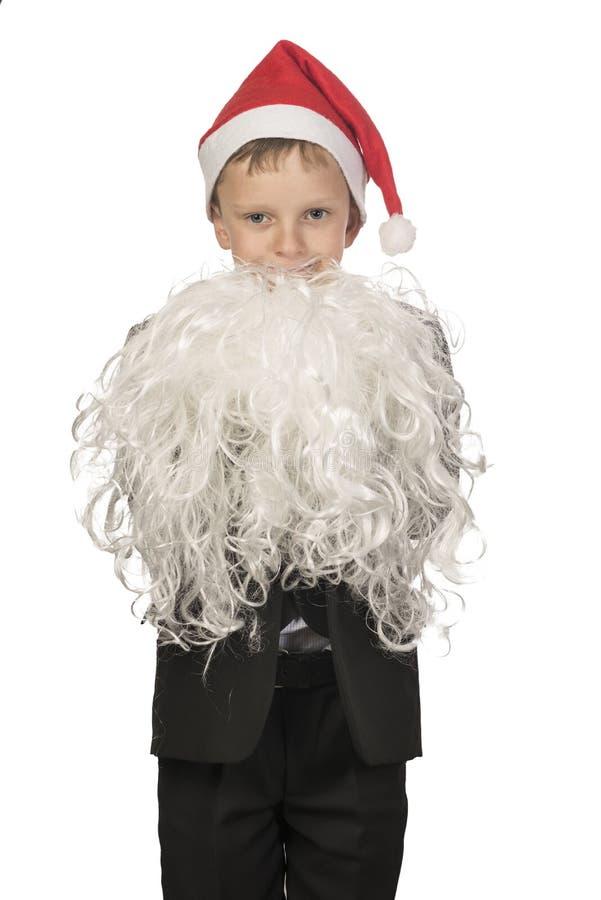 Pojken kläs som Santa Claus royaltyfri foto