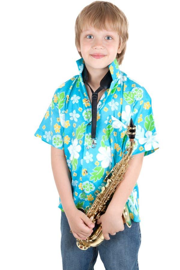 pojkesaxofon royaltyfri foto