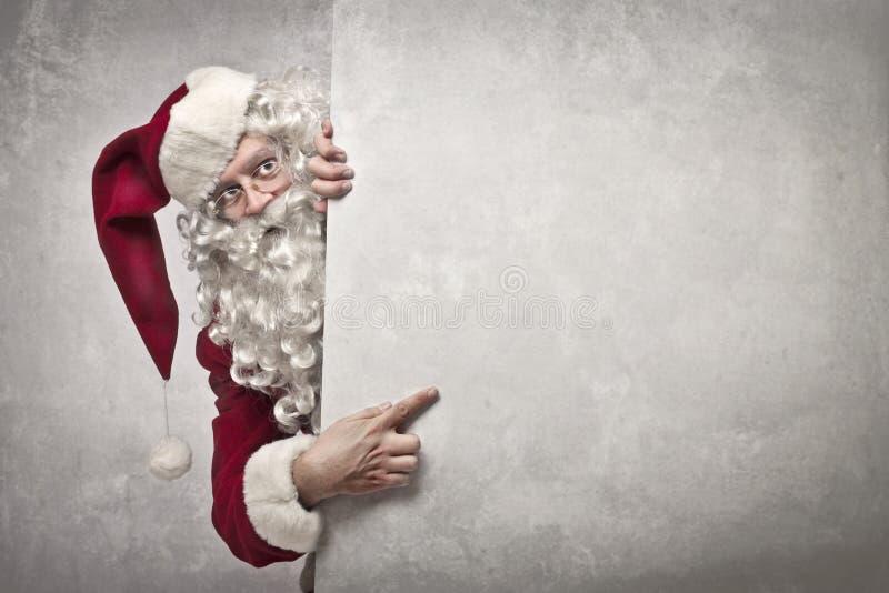 Pokazywać Święty Mikołaj obraz royalty free