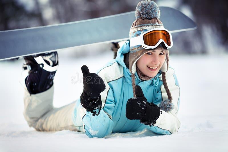 Pokazywać aprobaty żeński snowboarder obrazy royalty free