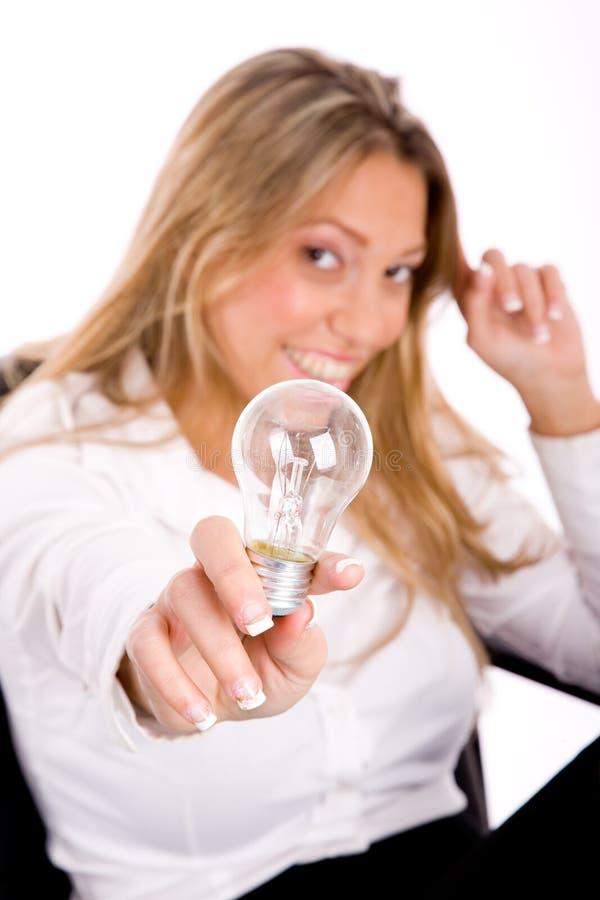 pokazywać uśmiechniętego odgórnego widok żarówka bizneswoman zdjęcia stock