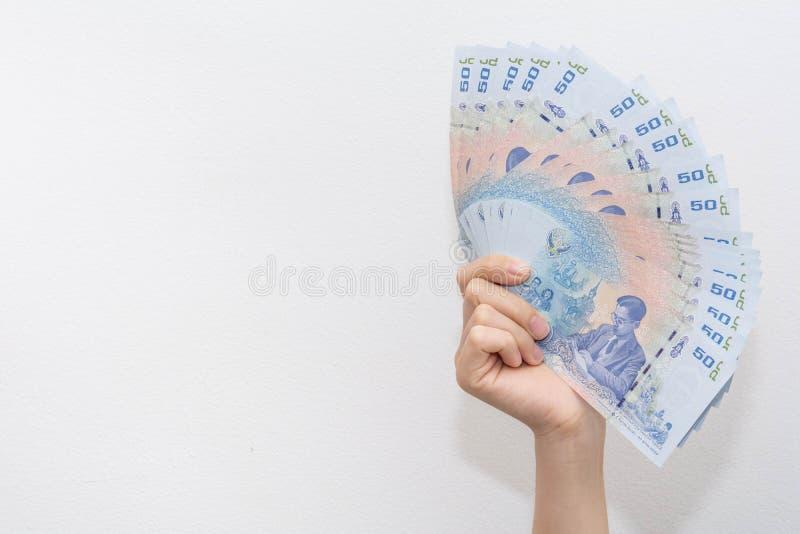 Pokazywa? pieni?dzy banknoty na bielu fotografia royalty free