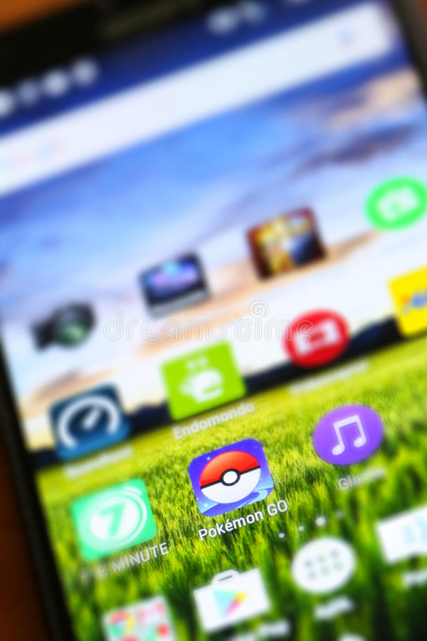 Pokemon går app arkivbild